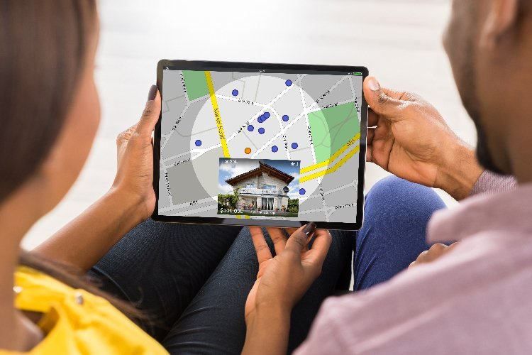 couple with tablet with real estate map
