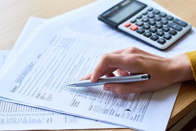 person working on tax forms
