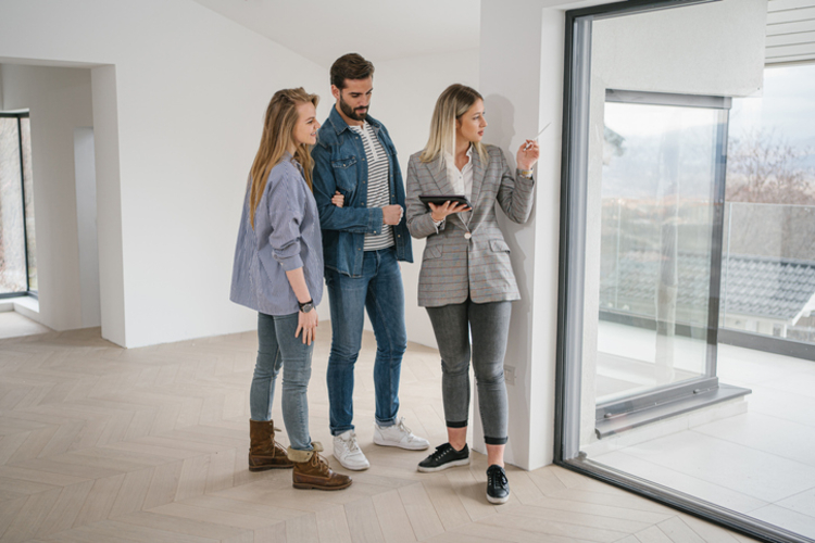 real estate agent showing couple house