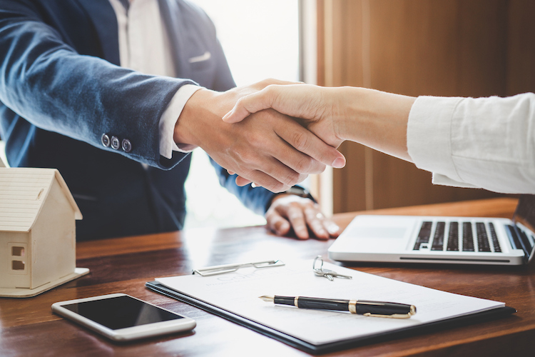 seller and agent shaking hands
